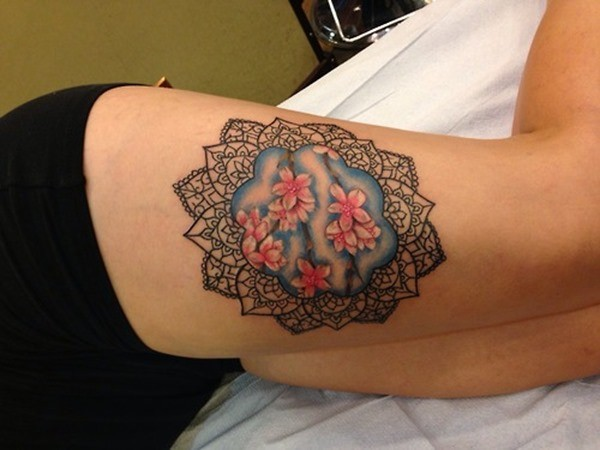 black_mandala_with_pink_flowers_tattoo_on_thigh_for_women.jpg