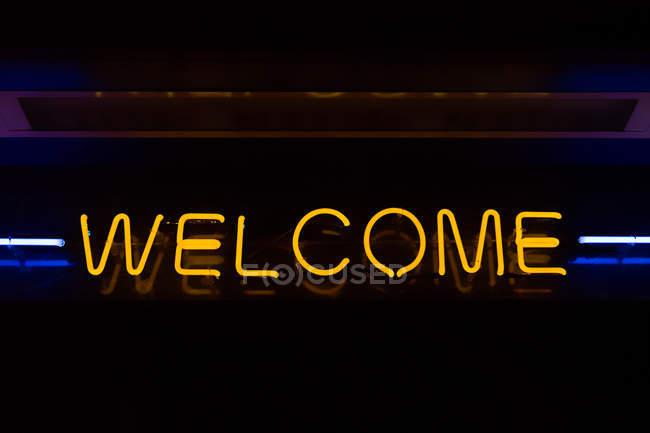 focused_171995042-stock-photo-welcome-neon-sign-dark-background.jpg