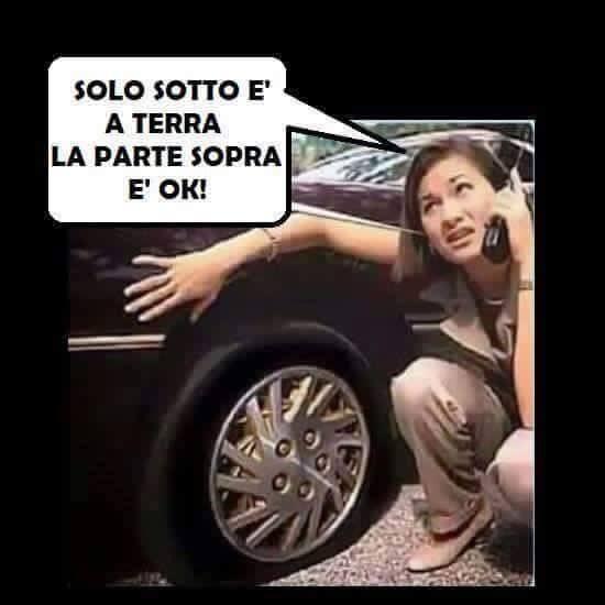 4083-donna-ha-forato-ruota-auto.jpg
