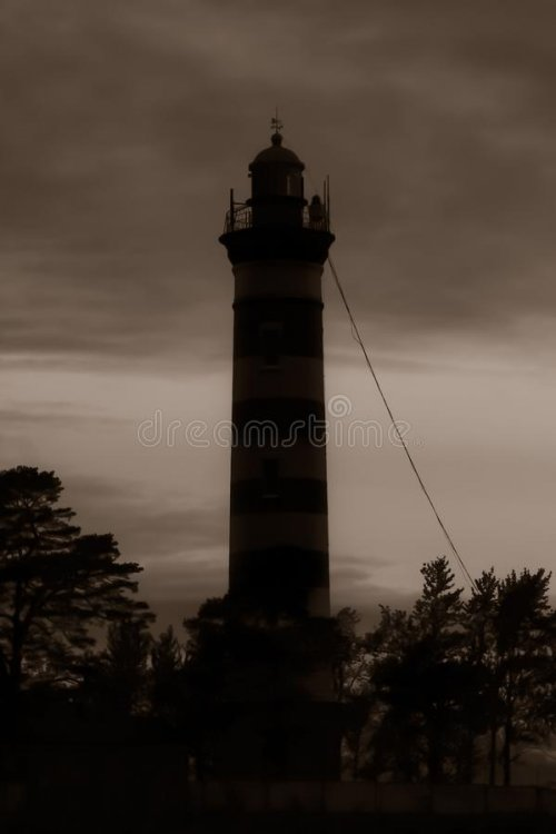 high-lighthouse-tower-silhouette-dark-dramatic-sky-163594451.jpg
