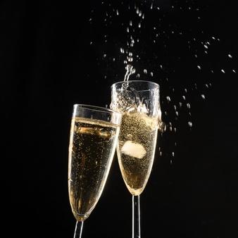glasses-champagne-with-splash_93675-53621.jpg